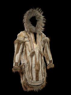 Man's parka, Inupiaq (Alaskan Inupiat Eskimo), circa 1900, Caribou hide/skin, fox skin/fur, wolf skin/fur, wool cloth, sinew. Sewn, pieced, appliquéd