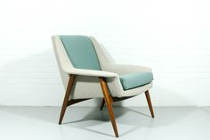 This dutch designed lounge chair from the 1960s has been newly upholstered in a combination of a very light taupe and blue woolfelt Kvadrat Divina fabric.