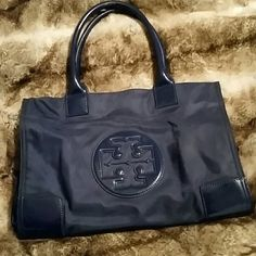 Tory Burch Mini Ella Tote I have a Tory Burch handbag.. Called the Mini Ella nylon tote. In navy blue nylon with patent leather trim. Used a few times. Has a slight peel on inside handle trim.  Minor markings on inside.  Overall still a great little bag. Tory Burch Bags Totes