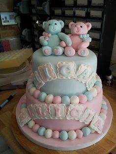 Pink and blue christening cake for twins, with teddy bears, names, and icing beads Pink Christening Cake, Birhday Cake, Baby Shower Cake Designs, Father's Day Breakfast, Twin Birthday Cakes, Torta Baby Shower, Twins Cake, Teddy Bear Baby Shower, Cake Tutorial