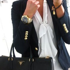 navy blazer with gold accessories and the bow shirt underneath