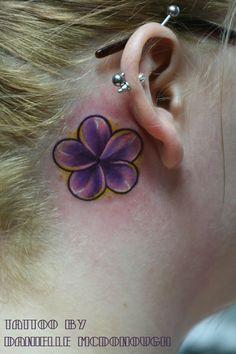 purple flower ear tattoo