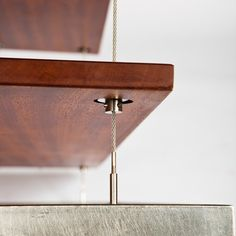 One of a kind piece handcrafted and designed by Southern Califonia architectural/furniture designer Taylor Lawson Donsker (www.tdonsker.com). Utilizing the strength and rigidity of a welded steel frame, suspended shelves elevate to an almost weightless appearance. The rich brown hues of the adjustable Mahogany shelves, hand rubbed in 100% pure tung oil (non-toxic), contrast against the dark steel to accentuate the floating concept while thin, stainless steel supporting cables seemingly…