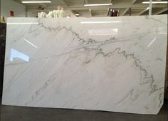"2.25""  countertops  white macaubas at some yards and was called luce di luna and calacutta quartzite at other yards. Also called bianca quartzite.  cross-cut format has fewer linear veins. The other format is straight cut, with the more striped effect"