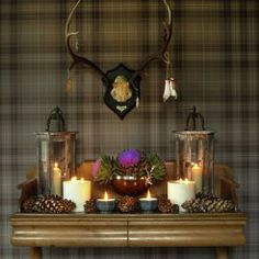 'Hogmanay' console table/tartan wallpaper styled by Charis White for BBC Homes & Antiques magazine. Photograph: Catherine Gratwicke.