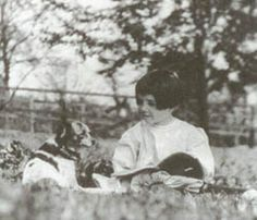 A young Rachel Carson reads next to her dog, Candy.
