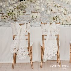 Lace bow chair covers for the Mr. & Mrs.