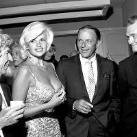 L-R Harpo Marx, Jayne Mansfield, Frank Sinatra, and Red Skelton at a party held at the Palm Springs Racquet Club 1959