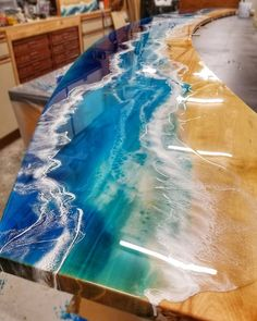 Jess Crow @ Crow Creek Designs creates very artistic resin river and waterfall tables. Jess Crow @ Crow Creek Designs creates very artistic resin river and waterfall tables. Diy Resin Table, Epoxy Wood Table, Epoxy Resin Table, Epoxy Resin Art, Resin Countertops, Kitchen Countertops, Countertop Kit, Wood Table Design, Resin Furniture