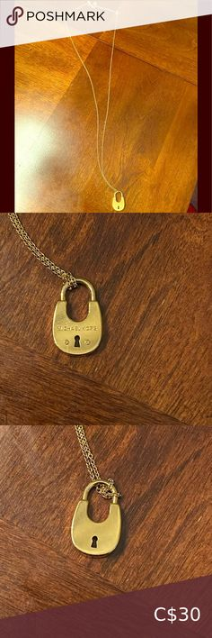 Michael Kors Lock Necklace Basically brand new. Never been worn. Has a few scratches on the front from hanging up hitting another necklace. Michael Kors Accessories White Michael Kors Watch, Michael Kors Rose Gold, Michael Kors Bedford, Michael Kors Wallet, Rose Watch, Michael Kors Sunglasses, Kate Spade Wallet, Closet, Accessories