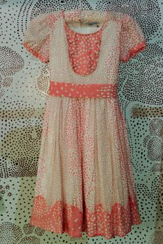 """Dot print 70""""s styling and coral tones, this dress ticks all the trends seen in womenswear by Baby Issa for summer 2011"""
