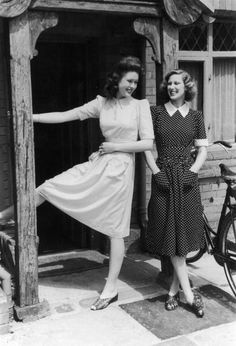 Two matching summer dresses in spotted materials. They have fitted waists and patch pockets and short sleeves with cuffs just above the elbow. They each need seven clothing coupons. Original Publication: Picture Post - 794 - Clothes for a Coupon Summer - pub. 1941 ~