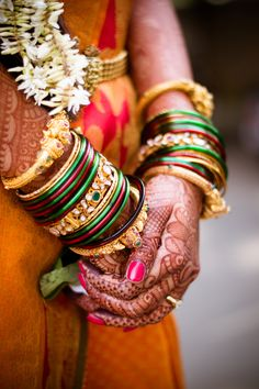Indian Bride with colourful wrist bangles and henna hand tattoo.