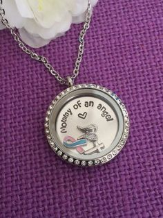 Mommy of an Angel Miscarriage Awareness Necklace, Angel Baby Floating locket angel wings, infant loss ribbon and cross. by DesignsByTeraW on Etsy https://www.etsy.com/listing/217349685/mommy-of-an-angel-miscarriage-awareness