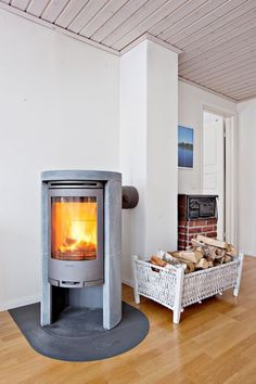 Grey Contura wood stove with soapstone.