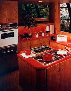"""This kitchen, featured in House Beautiful in January 1979, was built inside a glass encased, multi-level """"tree house"""" perched on the side of a hill overlooking Lake Sammamish outside of Seattle. The kitchen, placed on the house's highest level, was """"designed to be the focal point of all activities,"""" according to HB editors. """"It is at the center of the plan and has visual contact with all the spaces on the living level,"""" they wrote."""