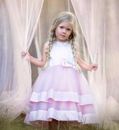 This gorgeous pink dress is a piece from our exclusive Gjergjani couture line. It's the perfect pink dress for any glamorous little girl! The bodice is made of