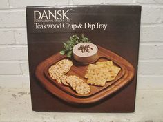Bar & Serving Ware  Subscribe to our feed. rss feed icon    Boxed and never used Dansk International Designs teak chip and dip tray designed by Jens Quistgaard. - $45  This vintage Dansk International teak wood Chip and Dip Tray designed by Jens Quistgaard is in as new condition. With the original packaging this wonderful tray and white ceramic dip bowl appear never to have been used. (See Photo.)  Like all of Jens Quistgaards designs this nice set has form and function...