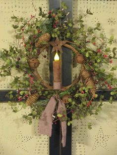 Prim Wreath...with rusty bells and candle.