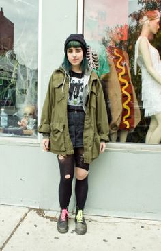 ripped jeans / band tee / green parka / beanie / boots