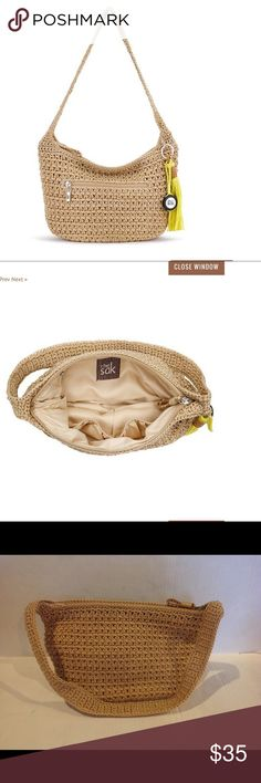 THE SAK. CASUAL CLASSICS CROCHET HOBO BAMBOO. The sak hobo bamboo is roomy and functional . Featuring - the SAK  signature CROCHET weave . Zipper closure. Front size outside pocket with zipper closure . Lining feature two multi function pockets and a zippered back wall pocket . THE height is 19.05cm. The width. Is 12.70cm, the length 33.02cm. The DROP length is 25.40cm. The Fabrication IS polypropylene. BRAND NEW WITH TAG. The Sak Bags Hobos
