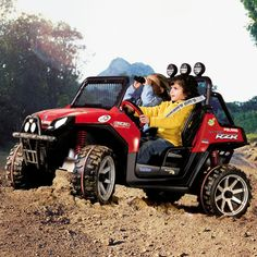 Peg Perego Polaris Ranger RZR Battery-Operated Ride On - Red. Really Expensive. For 5 to 10 year olds. Max weigh 150 lbs.