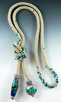 Rona Loomis bead crochet Lariat  HOW the HECK do they add the big focal beads?! Gotta find out--I've got a few that would be awesome on one of these ropes!