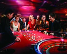 People playing at the casino || Image Source: https://www.queenstownnz.co.nz/assets/Tourism-Operators/images/_resampled/CroppedFocusedImageWzE0NjAsMTE3MiwieCIsNTMwXQ/CMYK-US-Web-Coated-SWOP-v2-Roulette.jpg