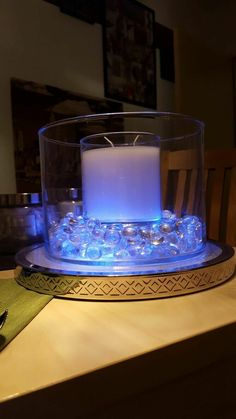 Creative way to use out to glow tray, our blown glass hurricane and a GloLite jar Candle! Fun and pretty!