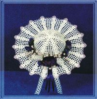 This lovely crochet hat is created using filet crochet and shells