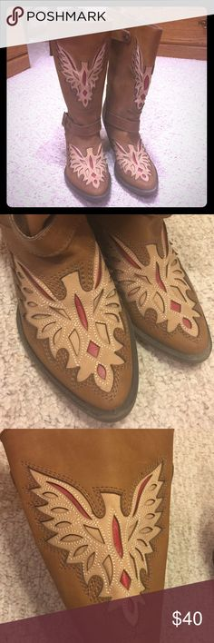 Women's Mojo Moxy cowgirl boots Women's size 10 Mojo Moxy cowgirl boots. These are absolutely gorgeous and unique boots. They have a laser-cut design on the toe and shaft of the boot with red detailing that looks like a Phoenix (without a head). There are buckles around the ankle and back of boot. The calf part is pretty wide so these would work if you have thicker legs. These haven't been worn more than a handful of times and the last time was maybe 4 years ago. There is very minimal wear…