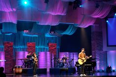 A sweet set from Benjamin James Hunt, the Lighting and Scenic Directorfrom Browns Bridge Community Church in Cumming, Georgia. This set incorporates floating translucent fabric, foam brick walls lit from the ground, and some sweet patterned panels.