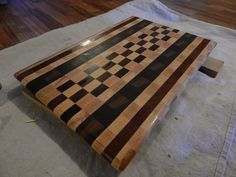 This is and end grain cutting board that I made.  I put together a few designs, and put them to a vote to see what people liked the most.  This design was the winner, and it sold within hours of being finished.