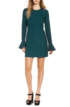 Free shipping and returns on Leith Bell Sleeve Sheath Dress at Nordstrom.com. A stretch-crepe sheath dress is sleekly modern with a retro-inspired twist, thanks to long sleeves that flare just above the wrist in a dramatic bell shape. The gorgeous jewel-tone hue and flirty back keyhole make this the perfect style for dressing to impress over the holidays.