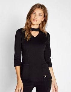 The Mock Neck Top in Black is a contemporary addition to women's medical scrub outfits. Shop Jaanuu for scrubs, lab coats and other medical apparel.