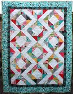 modern quilt for twin coverlet, toddler bed, or throw quilt // diamond rings // it's a hoot. $230.00, via Etsy.