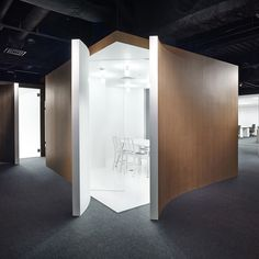 Walls are peeled back to reveal meeting rooms at this office in Yokohama by Japanese design studio Nendo