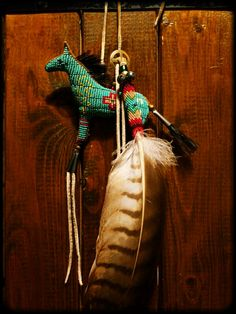 Beaed Horse Amulet & White Hawk Feather