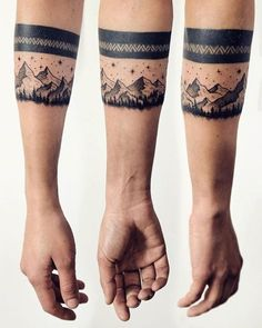 Nature inspired arm band tattoo for men.