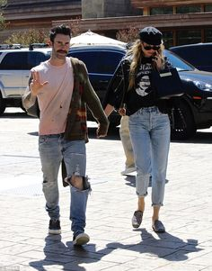 "Go for a classic tote like Behati's Balenciaga bag Click ""Visit"" to buy #DailyMail"