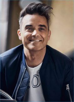 Marc O'Polo taps singer Robbie Williams to help celebrates its fiftieth anniversary. Robbie, along with his wife Ayda design special sweatshirts with personal… Oliver Twist, Dean Martin, Robbie Williams Take That, Eric Winter, Julian Wilson, Torch Song, Gary Barlow, Most Handsome Men, Portrait