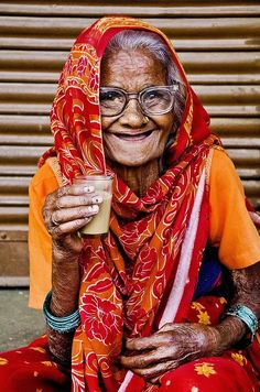 A Lady And Her Chai - Uttar Pradesh, India She looks sooo beautiful. Her eyes. I see her so full of love and life.