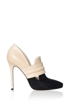 This pump by **Richard Braqo** is rendered in nubuck leather with contrasting black pony hair and features a thick front strap, cutout detail and stiletto heel.