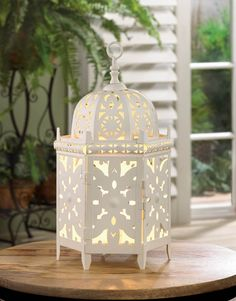 White Moroccan Table Lamp  Enjoy the beauty of a candle lantern with the flick of a switch instead of a strike of a match!   The single bulb inside will light up the intricate cutouts  @ amazingwebshopperonline.com