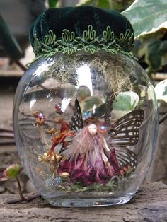 Queen Fairy with real butterfly wings - Miniature captured Pixie Fairy  in glass bottle - Fantasy woodland spirits. definitely a cute idea for a little girls room.