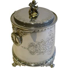 Antique English Figural Biscuit Box c.1880 In Silver Plate - Cherubs from puckerings on Ruby Lane | the ultimate cookie jar! Though at this price I would expect it to be at least 800 silver, not plate!