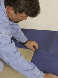 Practice laying out vinyl tile before peeling off the backing.