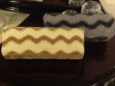 Crochet bag, clutch bags in ecrou-gold and silver-grey