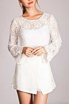 Pretty and lacey white top with slight bell sleeves. Looks great with a white or colored camisole beneath. Pair with spandex capri leggings, shorts or a fun skirt.   White Lace Top by Umgee USA. Clothing - Tops - Long Sleeve Chicago, Illinois
