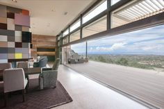 Was it the convenience of having the lights and motorized shades operate automatically that convinced Santa Fe homeowners Rick and Cynthia Torcasso to inve